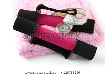 Black-pink soft dumbbell with handle strap over white Stock photo © Melnyk