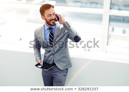 Businessman in Formal Wear Speaking on Telephone Stock photo © robuart