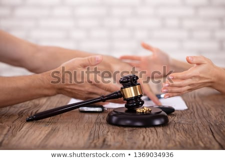 Couple Arguing Each Other And Mallet With Golden Rings Stock photo © AndreyPopov