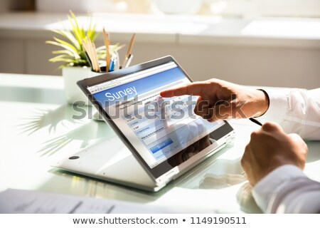 businessman filling online survey form on hybrid laptop stock photo © andreypopov