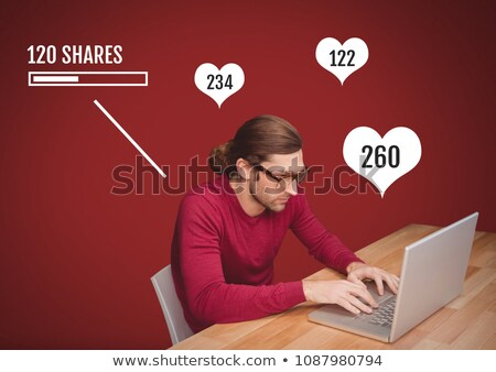 man on laptop with shares and likes status bars stock photo © wavebreak_media