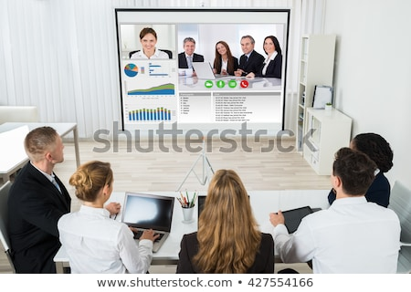 businesspeople discussing graphs through videochat stock photo © andreypopov