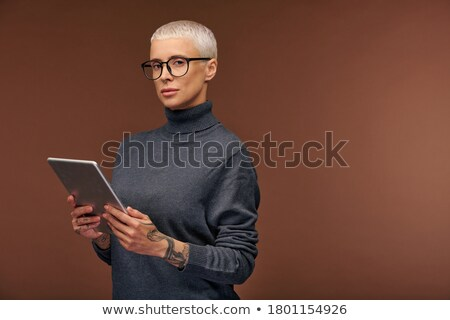 Successful mature elegant businessman with tablet looking at you Stock photo © pressmaster