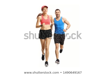 Stock photo: Portrait Of Young Man Jogging On White Background