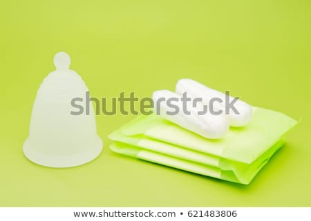 Different types of feminine hygiene products - menstrual cup and tampons Stock photo © galitskaya