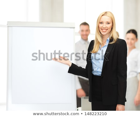 bussiness, meeting and education - businesswoman with flipchart in office Stock photo © galitskaya