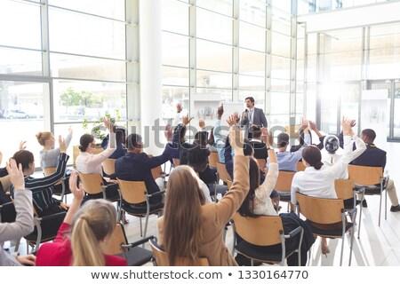 Vista posteriore interattivo uomini d'affari ascolto Foto d'archivio © wavebreak_media