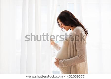 portre · koyu · esmer · hamile · kadın · yalıtılmış · beyaz · eller - stok fotoğraf © alexandrenunes