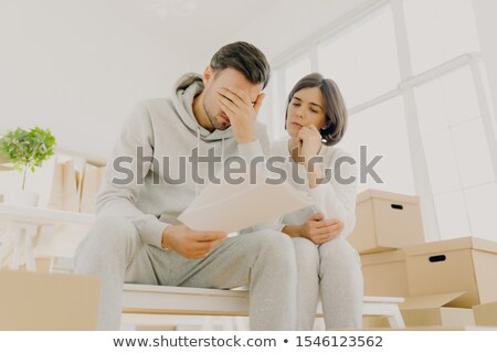 Distressed family couple have debt problem, being not able to pay apartment rent, have to leave hous Stock photo © vkstudio