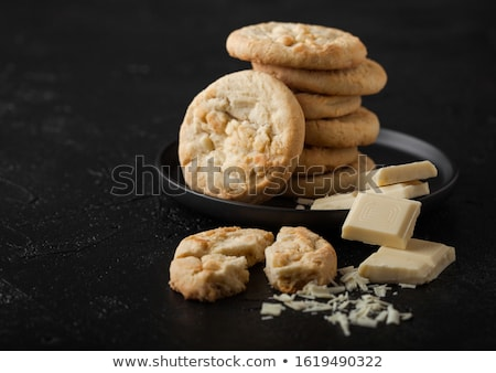 White chocolate biscuit cookies with chocolate blocks and curls on white background. Stock photo © DenisMArt