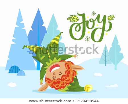 Holiday Joy Caption, Elf Playing Outdoor in Forest Stock photo © robuart