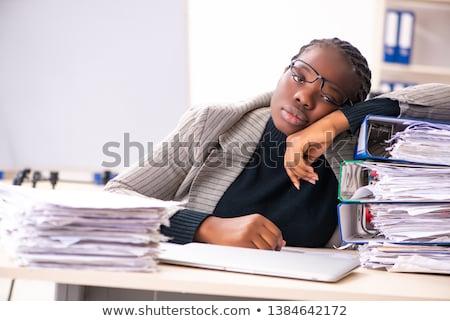 Black female employee unhappy with excessive work  Stock photo © Elnur
