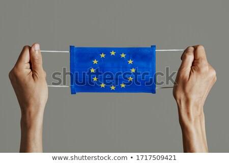 Máscara cirúrgica europeu bandeira homem Foto stock © nito