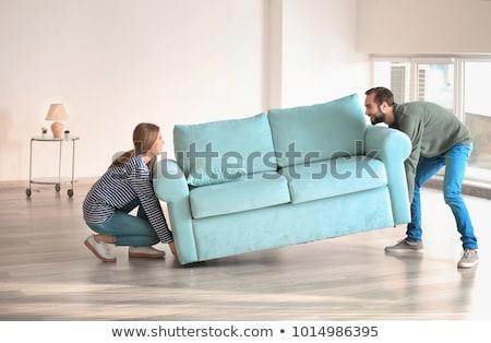 Feliz casal em movimento sofá nova casa alojamento Foto stock © dolgachov