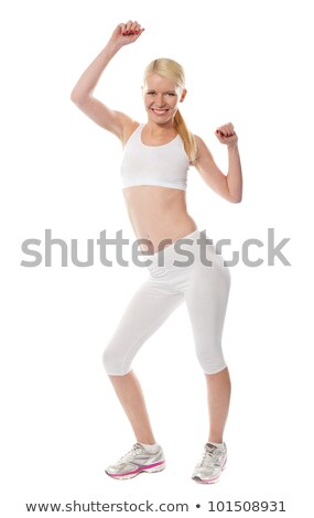Glamorous Young Woman Poses In Gym Fitness Outfit ストックフォト © stockyimages