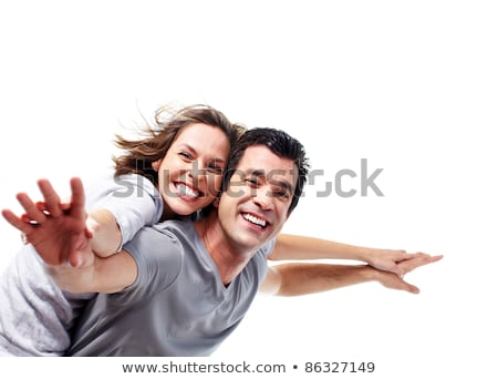 Young love couple smiling. Over white background  stock photo © dacasdo
