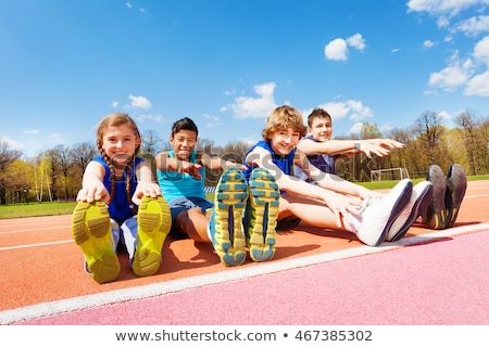 girl and boy doing exercises outdoors Stock photo © photography33
