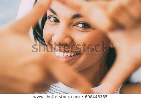 mulher · rosto · sorridente · retrato · jovem · adulto · amarelo - foto stock © ampyang