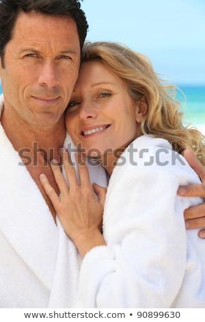 Couple in bathrobes on the beach Stock photo © photography33