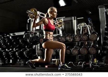 Lány súlyzók sport gyönyörű szőke nő Stock fotó © mariematata