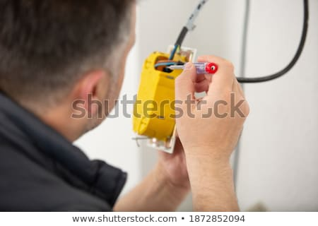 Tradesman using an electric screwdriver Stock photo © photography33