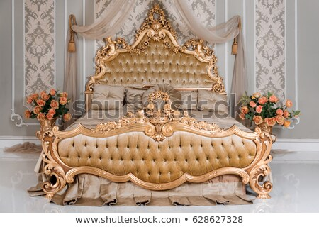 luxury double bedroom with golden furniture in royal interior stock photo © victoria_andreas