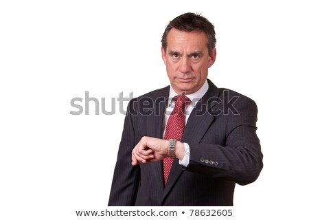 Frowning Angry Business Man in Suit Looking at Watch Time Stock photo © scheriton