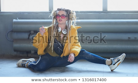 Beautiful young female with bright impudent make up stock photo © Elmiko