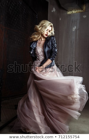 Beautiful blonde woman in lilac dress in luxury interior. Stock photo © Pilgrimego