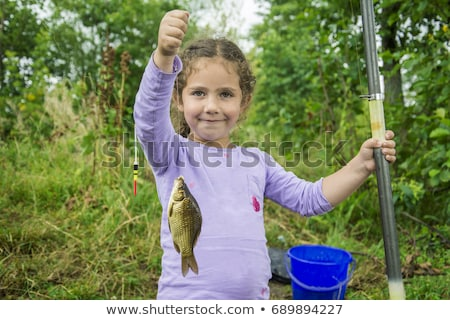 pretty young girl fishing on river in summer Stock photo © michey