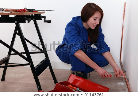 Labourer kneeling by tool box Stock photo © photography33