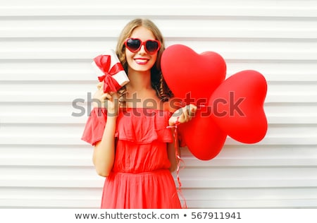 Woman holding a heart-shaped box Stock photo © photography33