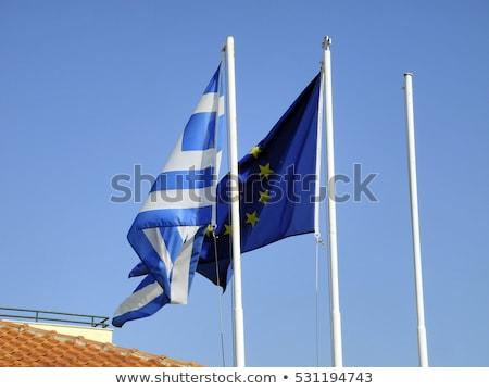 Eu Griekenland vlaggen blauwe hemel Blauw euro Stockfoto © timbrk