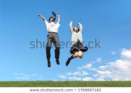 Dois mulheres jovens saltando blue sky jovem feliz Foto stock © rosipro