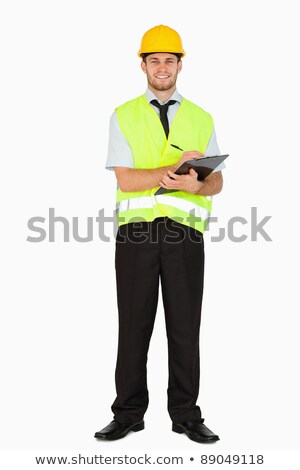 Young foreman in safety jacket taking notes on clipboard against a white background Stock photo © wavebreak_media