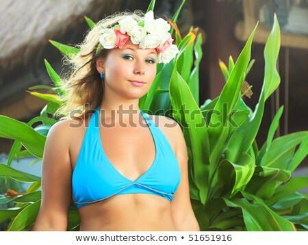 Bikini girl wearing Hawaiian flower smiling fresh Stock photo © Maridav