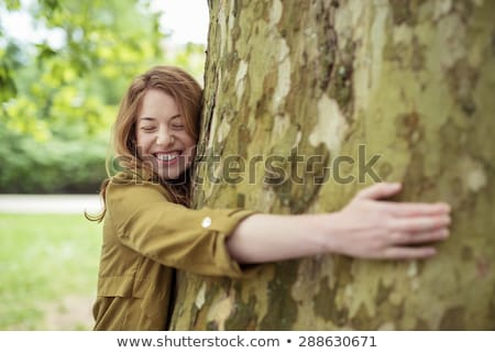 Pretty Teen Girl in a Tree Stock photo © 2tun
