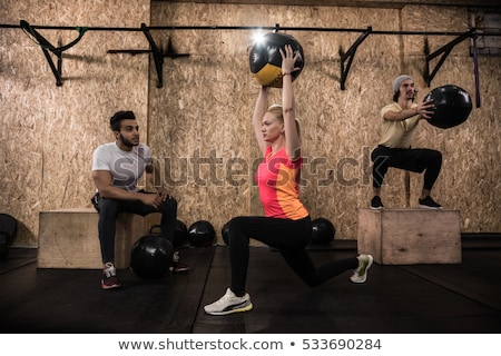 crossfit ball fitness workout group woman and man stock photo © lunamarina