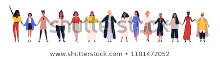 group of happy young women standing together friendship isolat stock photo © dacasdo