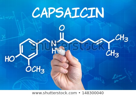 Stock photo: hand with pen drawing the chemical formula of capsaicin