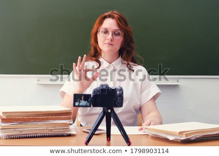casual woman with blackboard shows thumb up stock photo © feedough