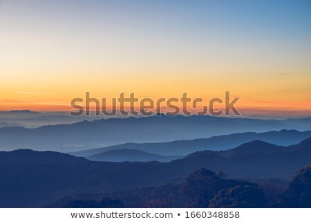 Stock photo: Winter mountains in evening and cloudy sky
