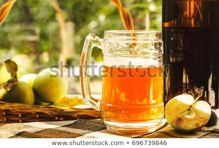Glass of Sparkling Apple Cider with Autum Leaves  Stock photo © tab62