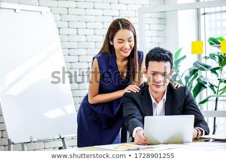 üzletasszony · flörtöl · kolléga · üzlet · nő · iroda - stock fotó © kzenon