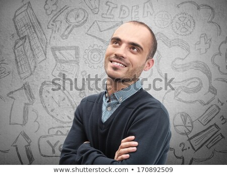 young business man thinking of his plans closeup face portrait a stock photo © hasloo