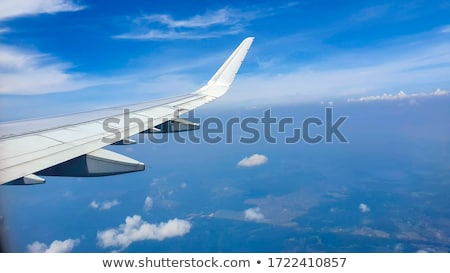 翼 航空機 日没 ビジネス 雲 光 ストックフォト © meinzahn