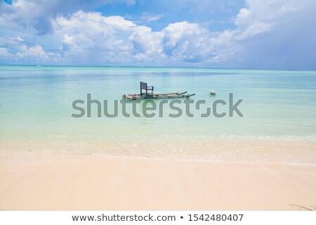 beach chair floating in the blue tropical clear sea Stock photo © meinzahn