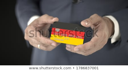 German Businessman holding business card with Germany Flag Stock photo © stevanovicigor