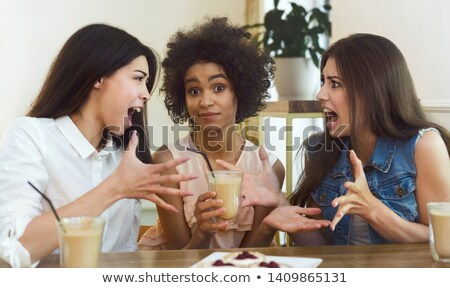 Woman blaming her friend Stock photo © bmonteny
