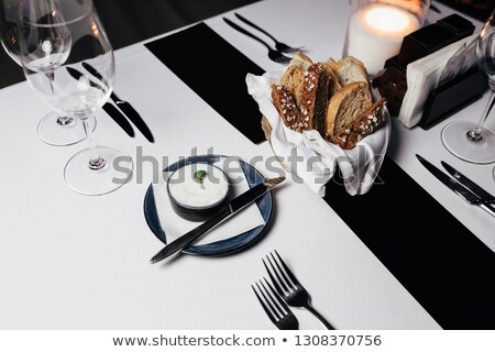 wooden table dinner setting with bread olives and wine stock photo © epstock
